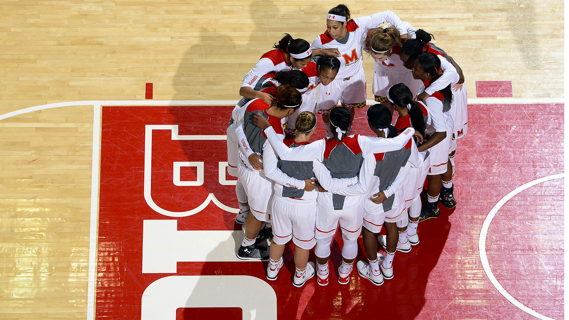 Maryland Women's Basketball huddle on the court at the Xfinity Center