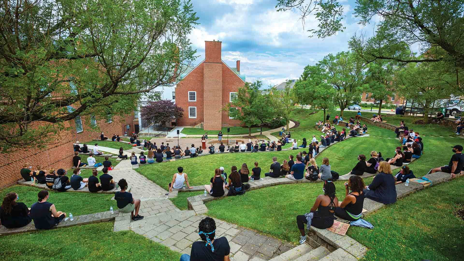 Students congregate at the Nyumburu Cultural Center Amphitheater after a Black Terps Matter protest in June 2020. Photo by Stephanie S. Cordle.