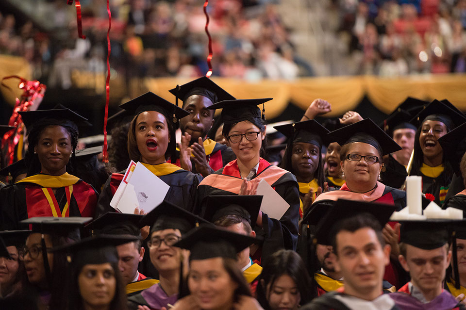 Group of graduates listening to the speaker at their commencement